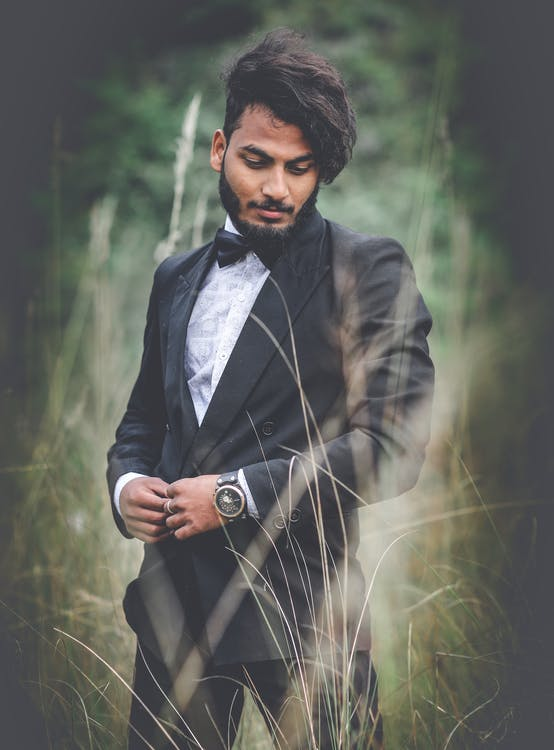 Photography of a Man Wearing Black Suit