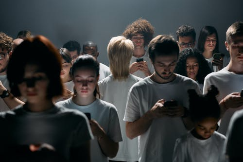 Photo of People Using their Smartphones