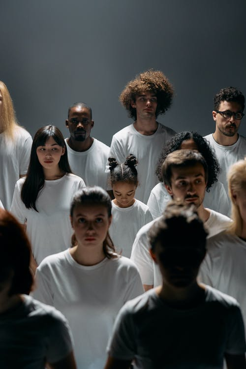 Group of People Wearing White Crew Neck Shirt