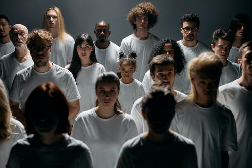 Photo of People Wearing White Crew Neck Shirt