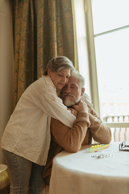 Elderly Couple Hugging Each Other