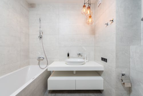 Modern Design Of Bathroom With Marble Walls  and White Washcloset