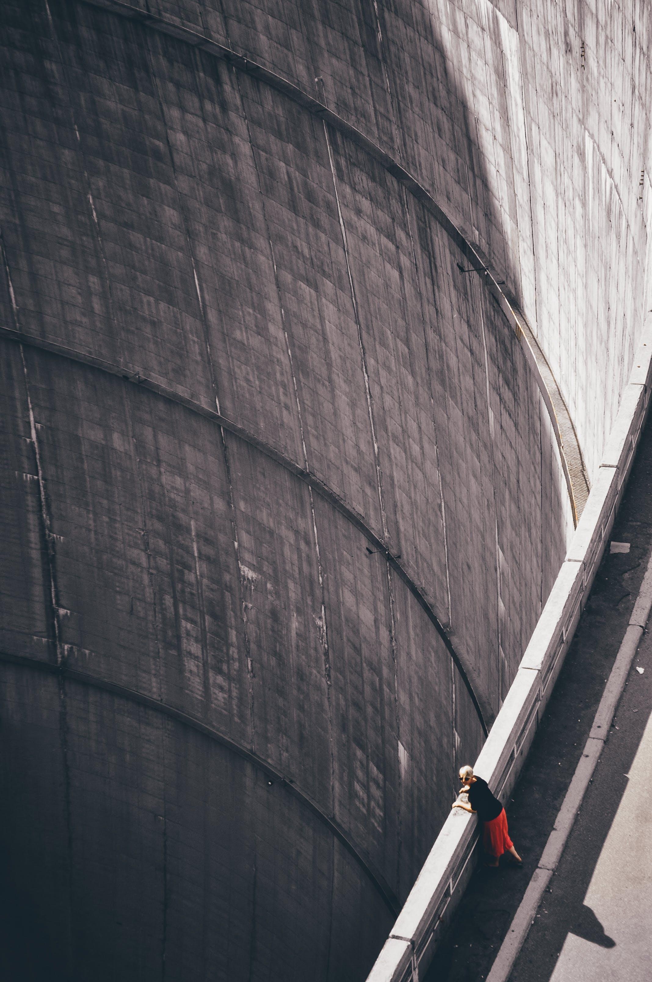 Woman Wearing Black Shirt Looking Down Through Hoover's Dam