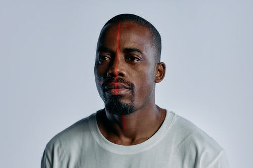 Portrait Photo of Man in White Crew Neck Shirt