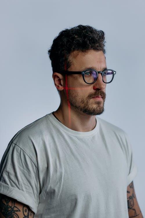 Photo of Man Wearing Black Framed Glasses