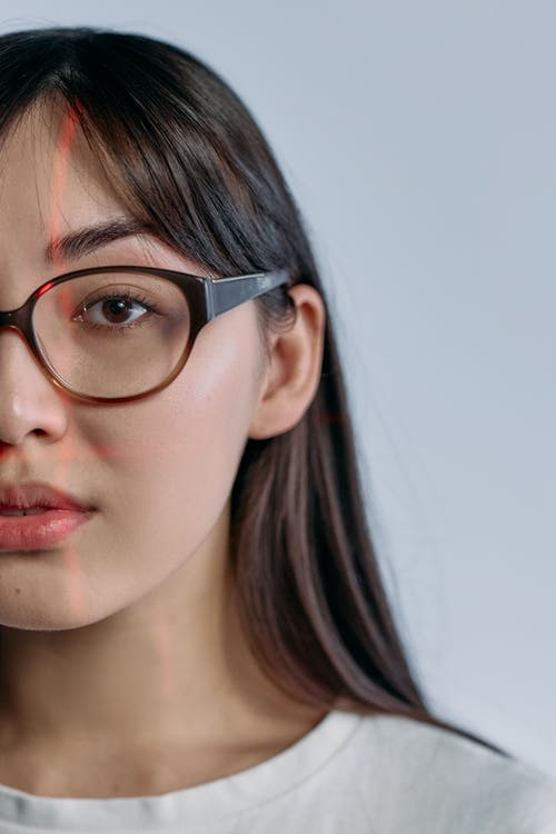 Photo of Woman Wearing Brown Framed Glasses