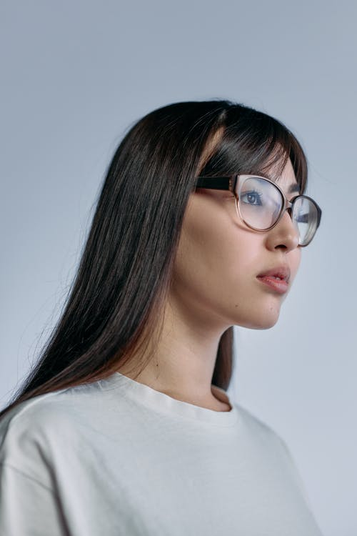 Photo of Woman in Brown Frame Glasses