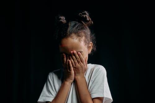 Photo of Girl Hiding her Face