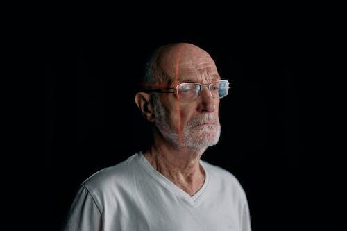 Man in White Crew Neck Shirt Wearing Eyeglasses
