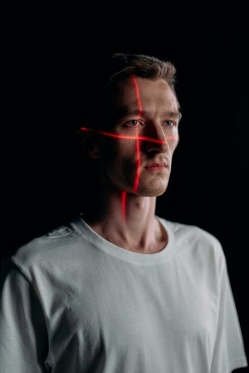Photo of Man with Laser Lines on his Face