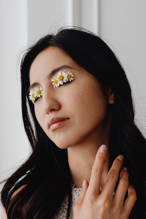 Woman with Flowers on Her Eyes