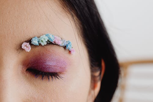 Close-Up Photo of a Person with Glittery Eye Makeup