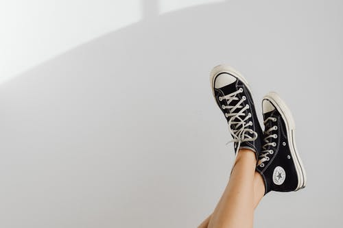 A Person Wearing a Converse All Star