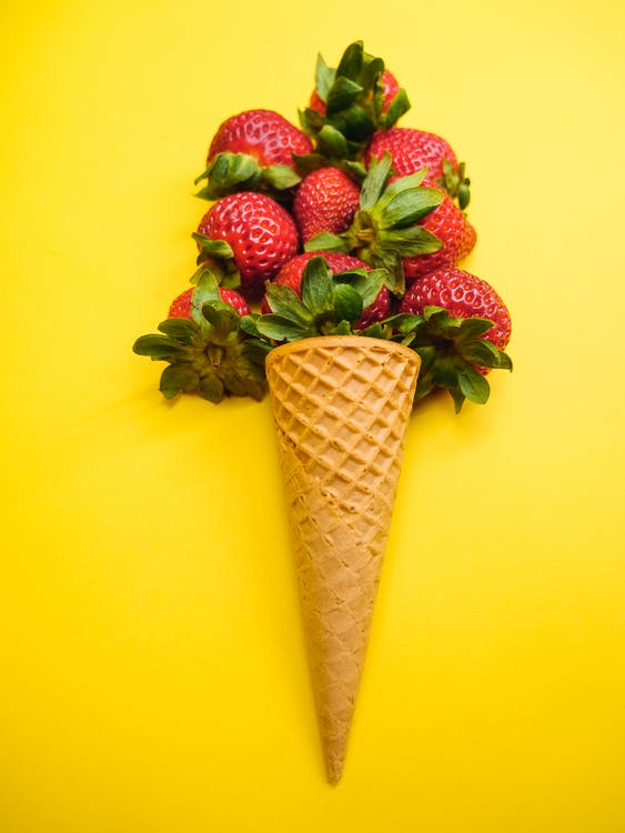 Strawberries on Brown Cone With Green Leaves