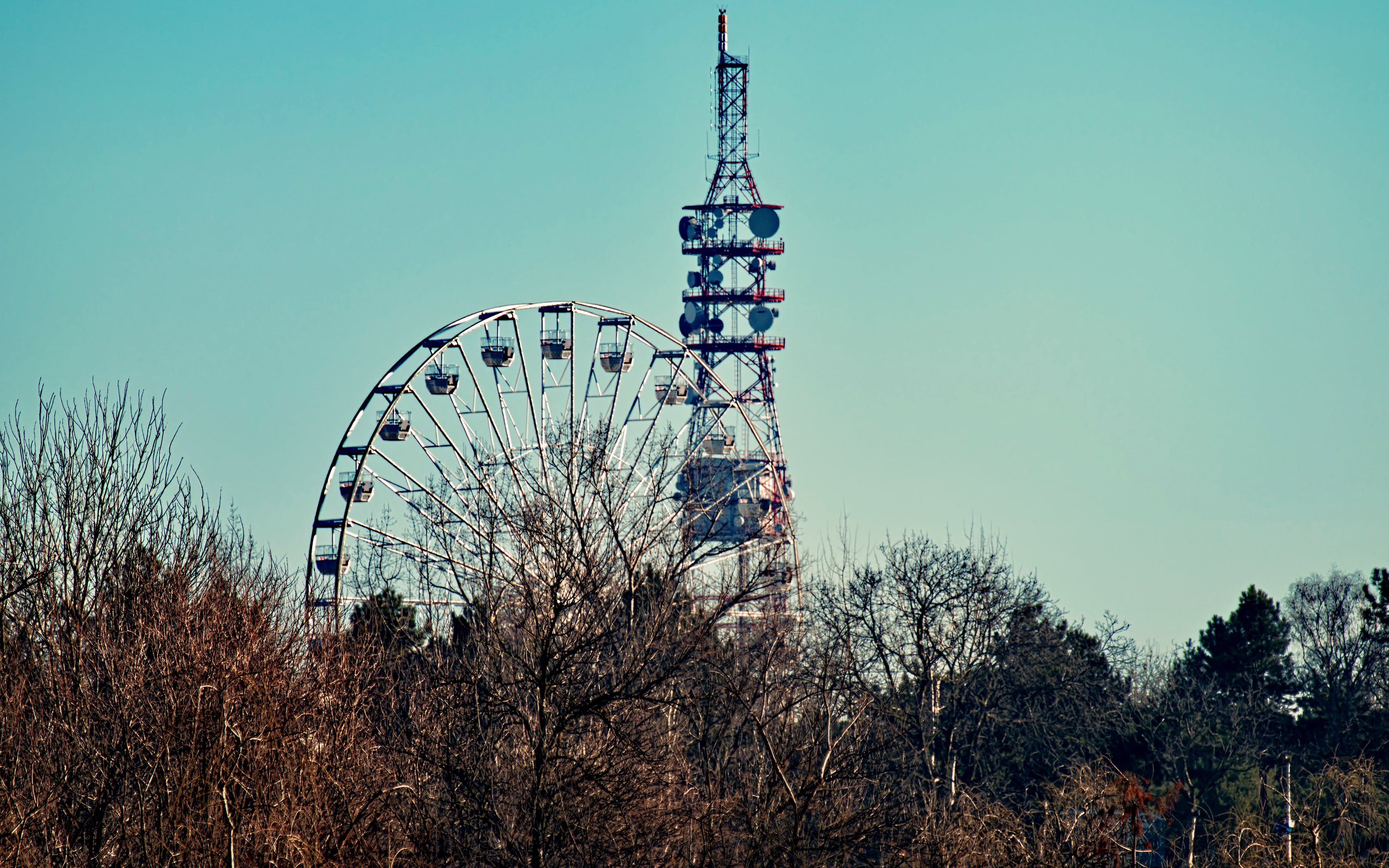 Photo of a Ferris Wheel Beside Tower