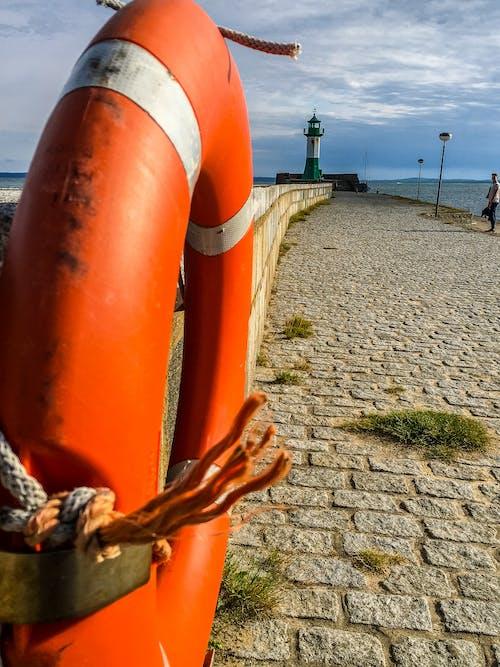 ışık kulesi, okyanus içeren Ücretsiz stok fotoğraf