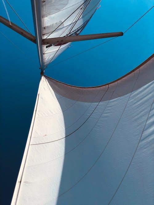 White Sail Boat on Blue Sky