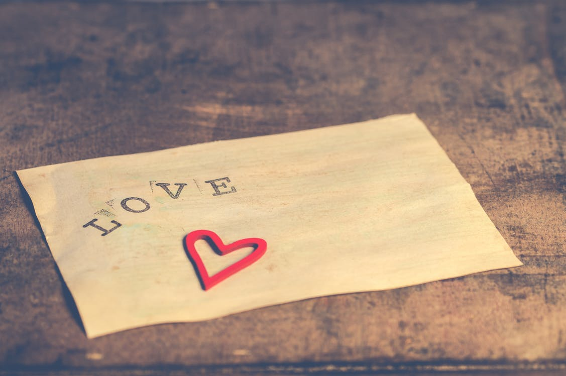 """White Paper Printed With """"love"""""""