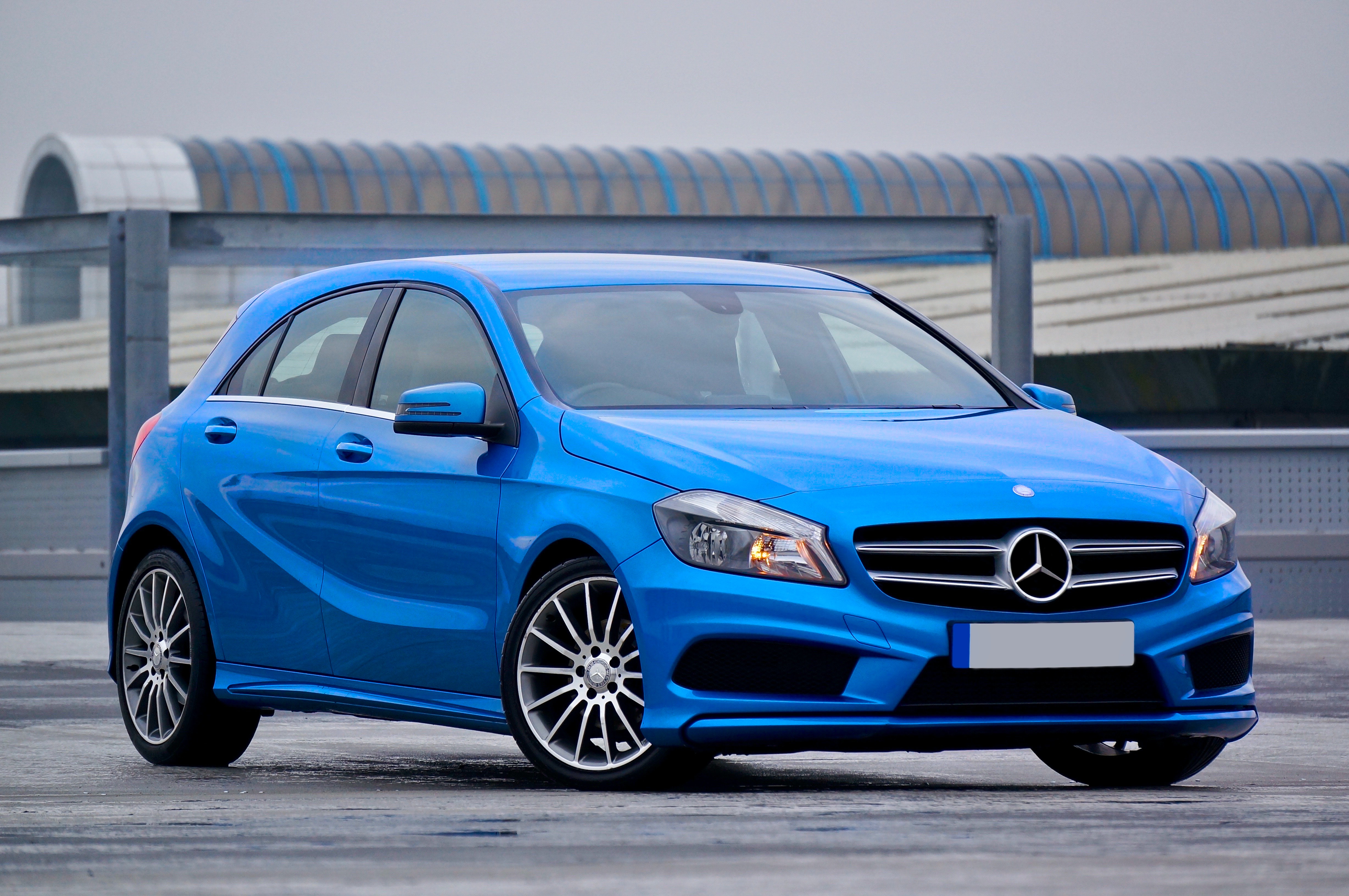 photography of a blue mercedes benz 5 door hatchback free stock photo