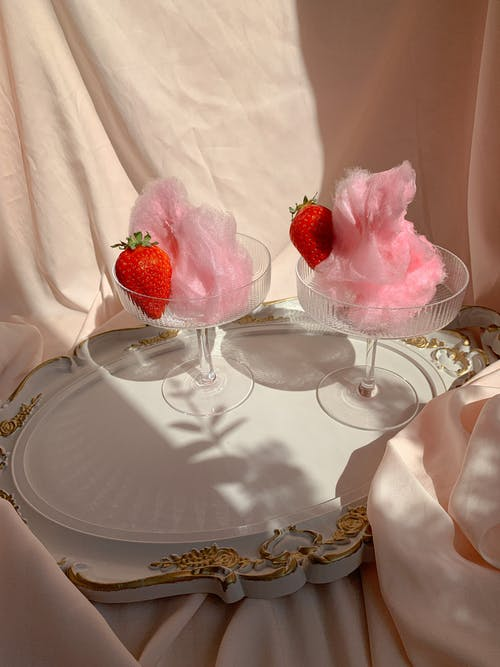 Pink Cotton Candy on Glasses with Strawberries