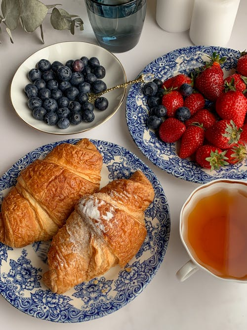 Bread and Strawberries on Plates