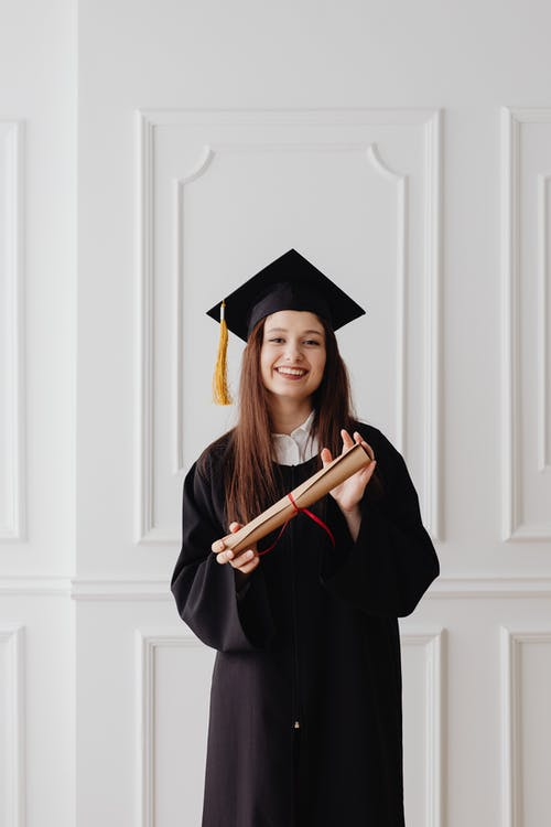 Woman in Academic Dress and Academic Hat