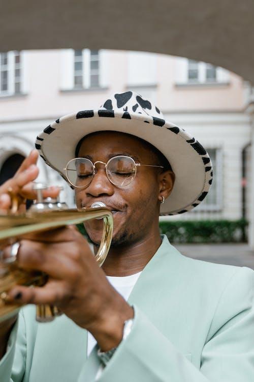 Man in White Hat Playing Trumpet