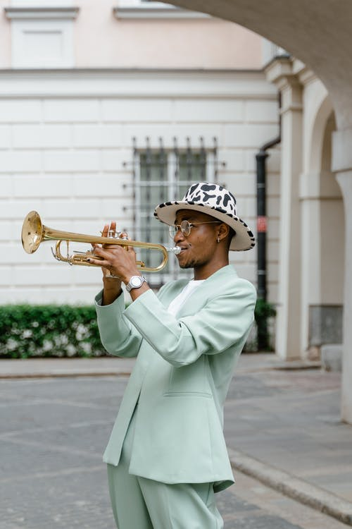 Man in Suit Playing Trumpet