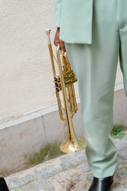Person Holding Brass Trumpet