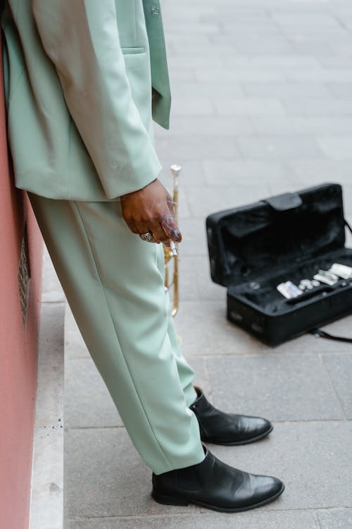 Man in Suit Holding a Trumpet