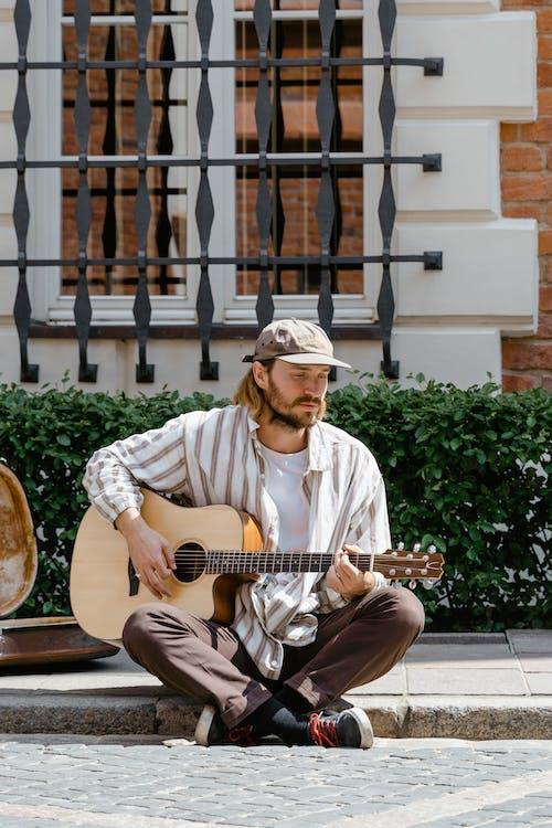 Man in White Dress Shirt Playing Guitar