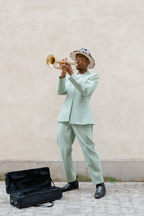 Man in Teal Suit Playing Trumpet