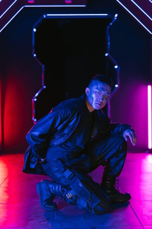 Man in Black Leather Jacket Kneeling