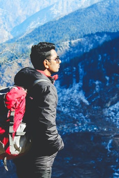 Man in Black Jacket Taking Selfie on Top of Mountain