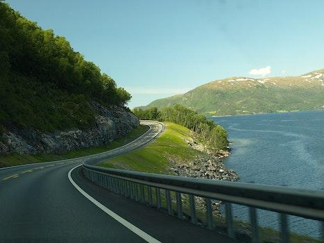 Concrete Road Near Body Of Water