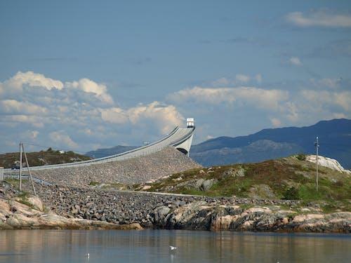 Foto profissional grátis de céu, costeiro, espaço, estrada