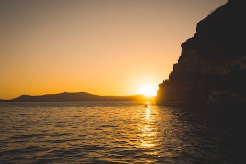 Fotos de stock gratuitas de cerca del mar, dorado, noche, puesta de sol