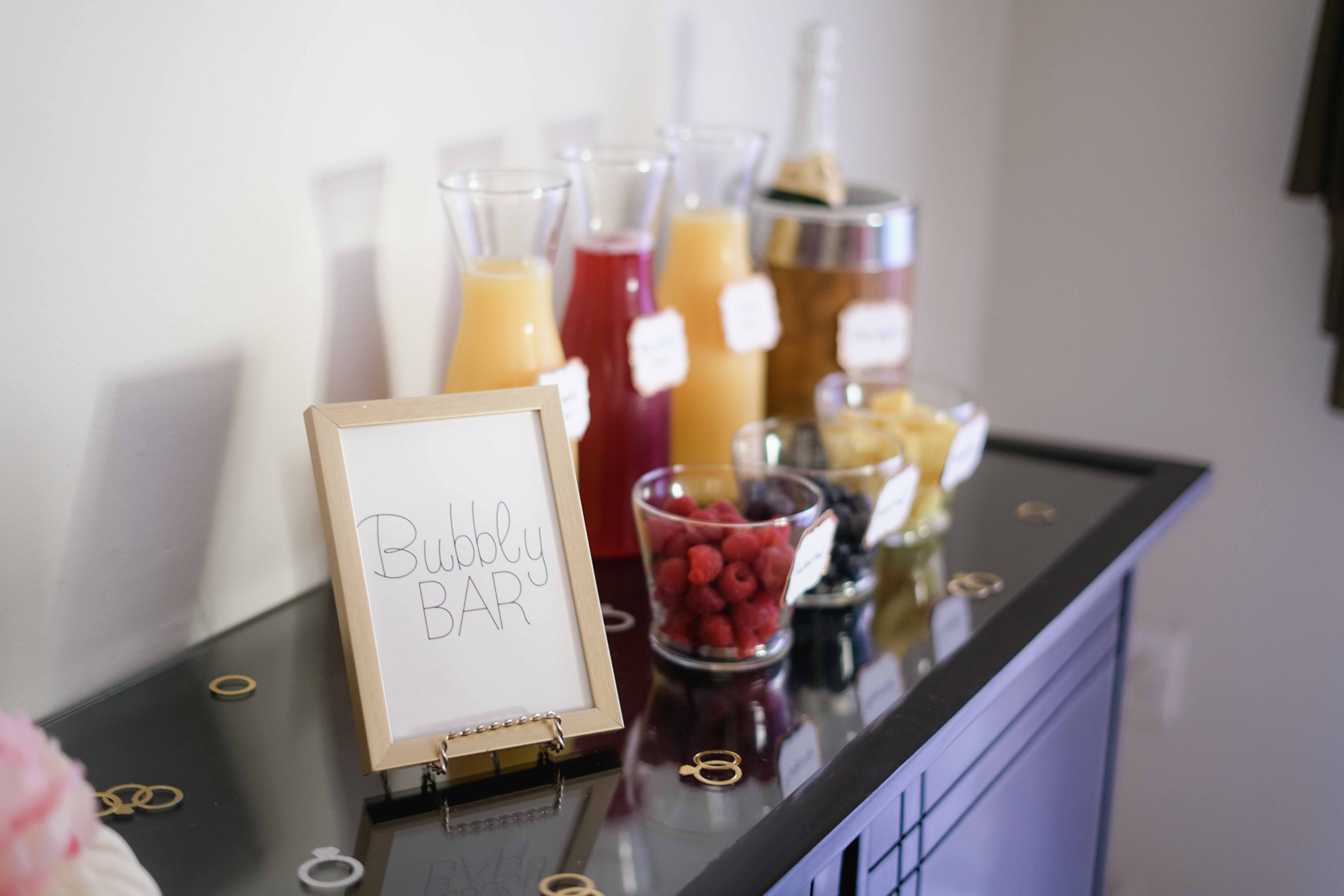 Bubbly Bar Sign With Several Assorted-color Liquid With Bottles on Top of Black Wooden Table