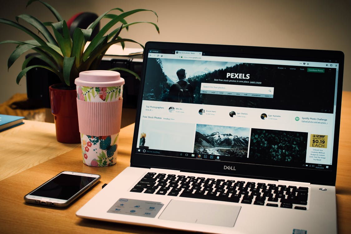 Photo of a Gray Dell Laptop Displaying Pexels Webpage