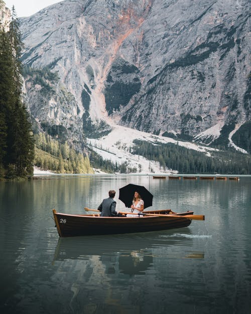 Person Riding on Boat on Lake