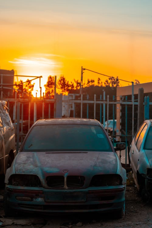 Cars Parked on Side of Road during Sunset