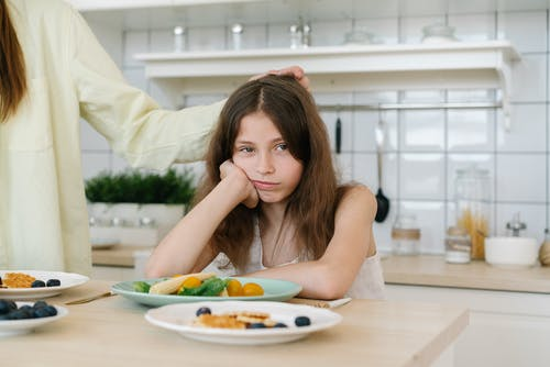 A Girl Does Not Want to Eat Vegetables