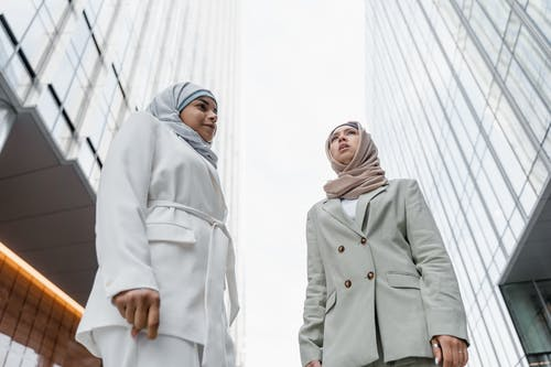 Women Wearing Coats and Hijab