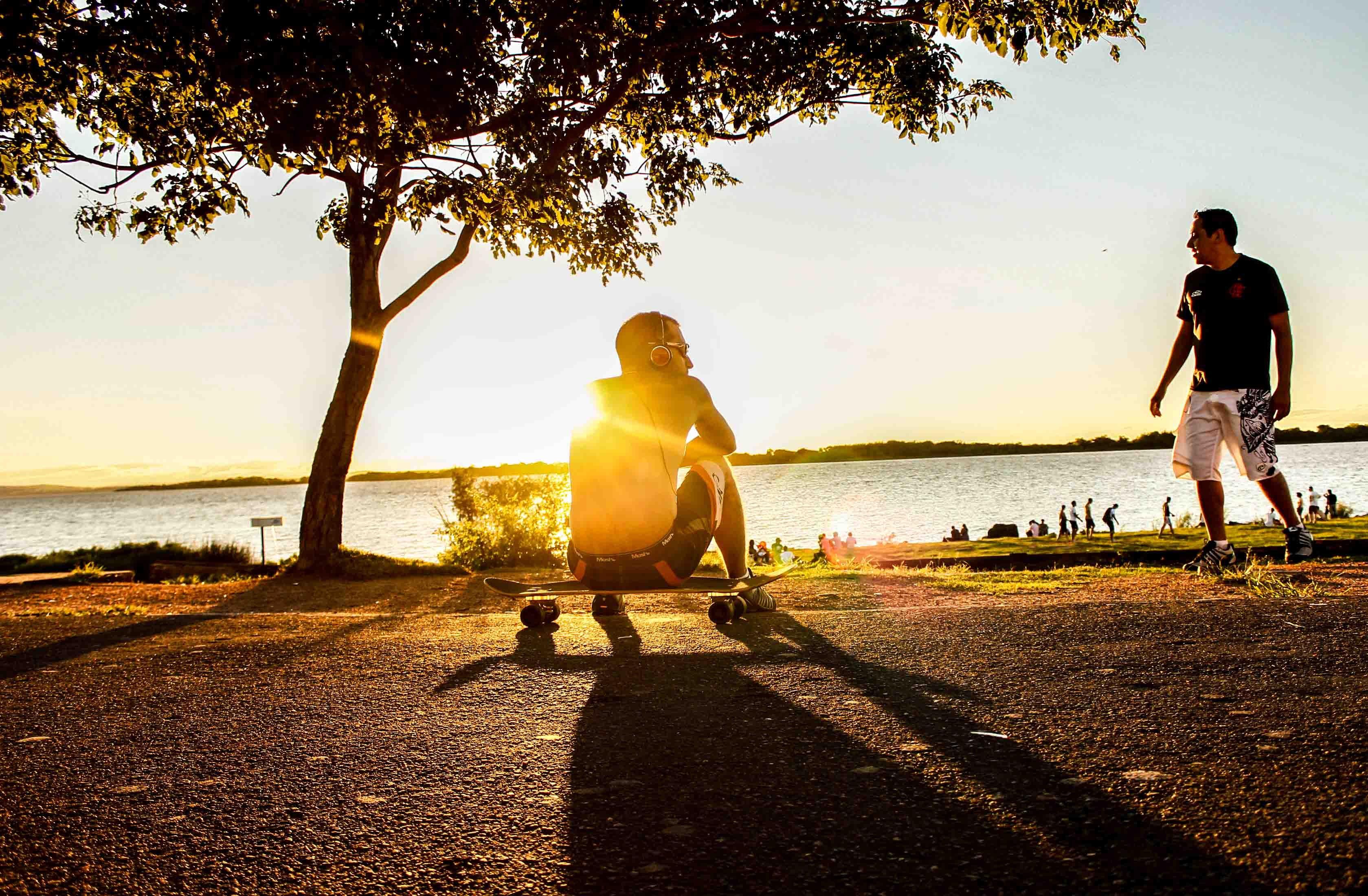 Photo of Man Sitting on Skateboard