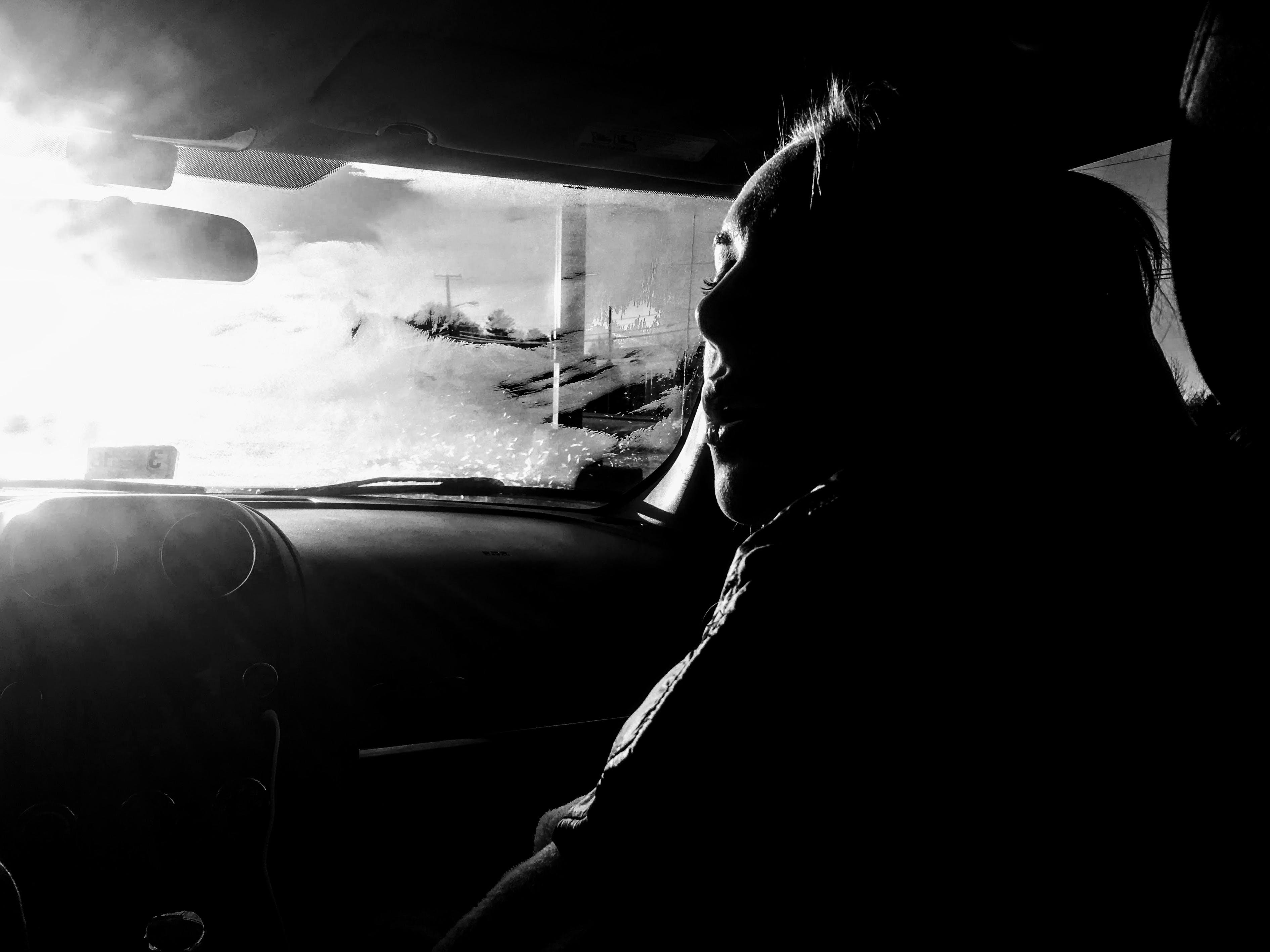 Woman Inside Car Grayscale Photo
