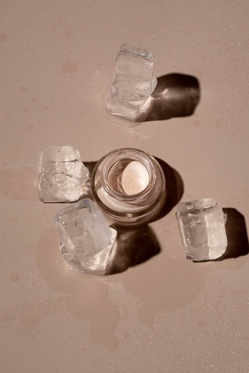 Clear Glass Bottle Beside Crystals