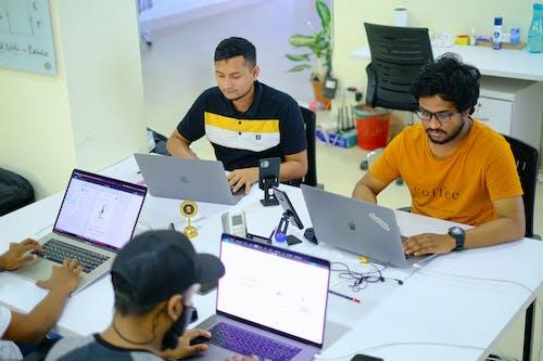 Man in Yellow Shirt Using Macbook