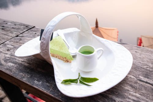 Photo of Match Cake and Matcha Drink on a Porcelain Plate