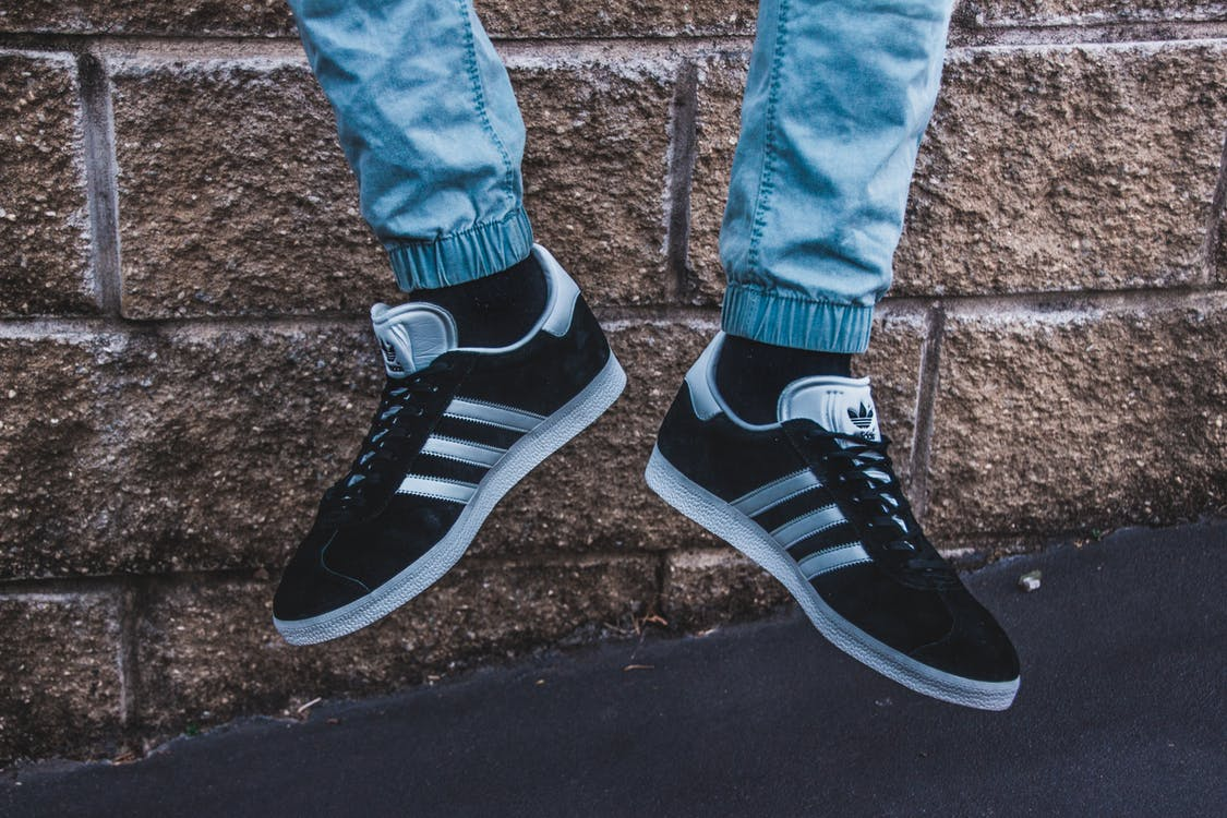 Photography of a Person Wearing Adidas Gazelle