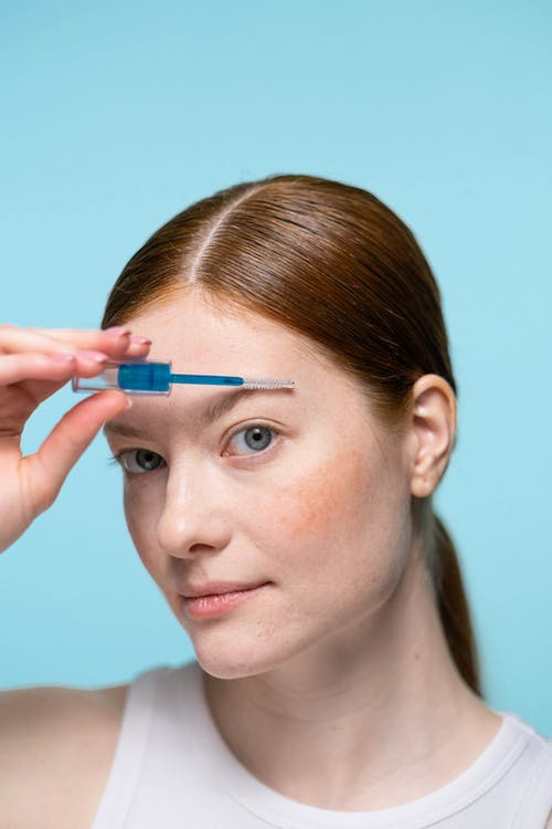 Woman With Blue Eyes Holding Blue Pen